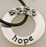 a braille affirmation charm