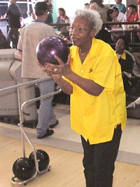 Photo of bowler raising funds for Seedlings