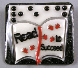 "Photo of ""Read to Succeed"" braille pin"