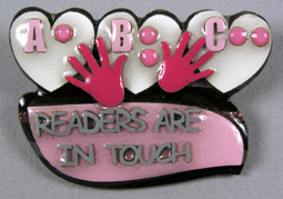"Photo of ""Readers are in Touch"" braille pin"