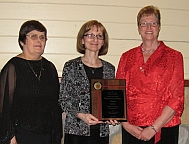 Photo of Debra Bonde receiving the award from DKG
