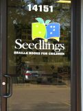 Photo of a Seedlings' front door with logo