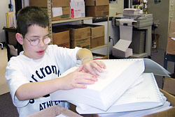 Kevin scanning new braille book titles