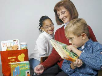 Adrianna & Evan read Seedlings books with founder/director Debra Bonde