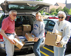 Volunteers take our books to the Post Office